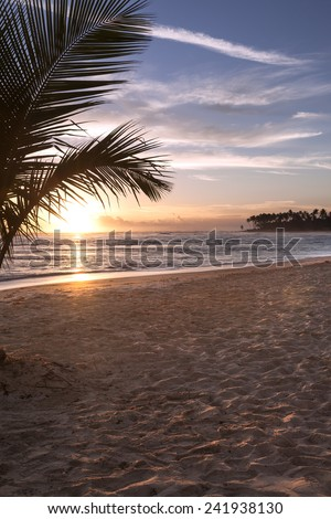 Sunrise over the ocean on a beach in Punta Cana, Dominican Republic. - stock photo