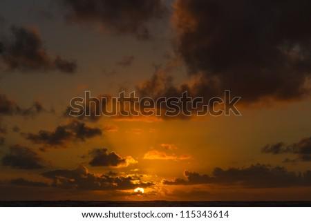 Sunrise over the Pacific Ocean as seen from Kauai - stock photo