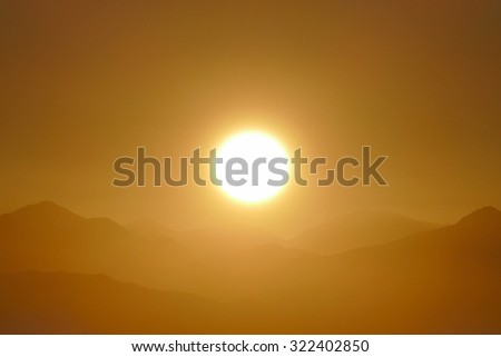 Sunrise over the peaks of the San Gabriel National Monument and Angeles National Forest in Los Angeles County, California. - stock photo