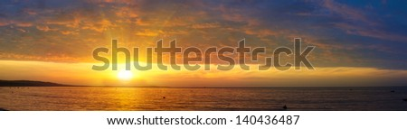 sunrise over the sea and the beach with clear skies