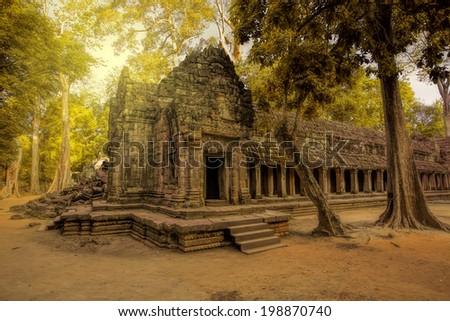 Sunrise over the Ta Phrom temple in Angkor, Cambodia - stock photo