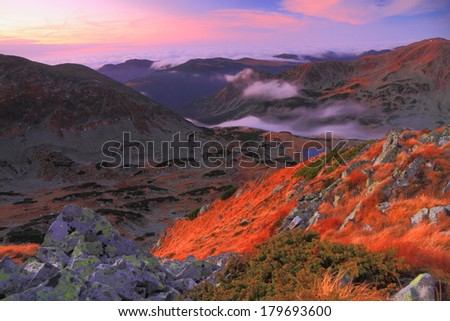 Sunrise over the valleys and mountains  - stock photo