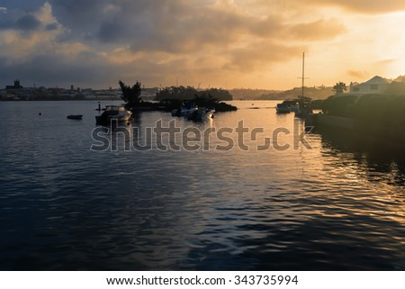 Sunrise over the waters of Hamilton Harbour, Bermuda - stock photo