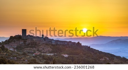 Sunrise over Tuscan Town of Montecatini in Val di Cecina near Volterra, Italy - stock photo
