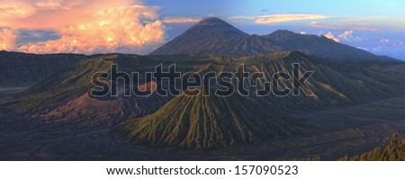 Sunrise over valley with active volcanoes. HDR panorama. Java island, Indonesia