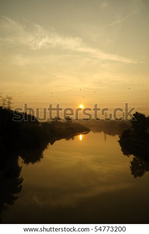 Sunrise panorama at electrical substations - stock photo