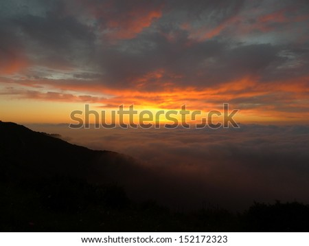 Sunrise/ red clouds on the mountain top View from the mountain peak