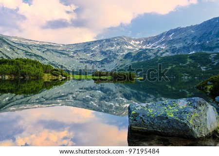 sunrise reflection on the beauty mountain lake