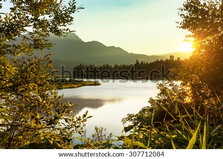 Sunrise scene on lake - stock photo