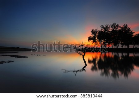 Sunrise seascape at Terengganu. Soft focus due to long exposure shot. Nature composition and vibrant colours. - stock photo