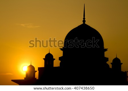 Sunrise Silhouette of a mosque in Putrajaya, Malaysia - stock photo
