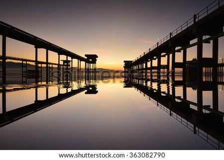 Sunrise silhouettes Bridge in Thailand.  - stock photo