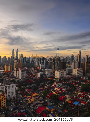 Sunrise skyline of Kuala Lumpur city with Petronas Twin Towers or Kuala Lumpur City Centre (KLCC) as part of the skyline  - stock photo