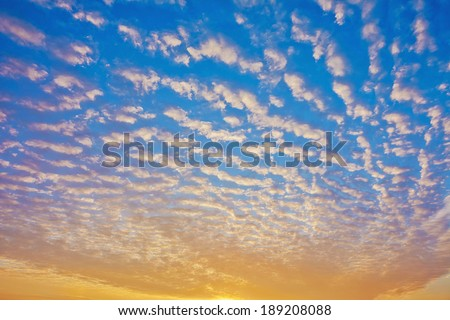 Sunrise / sunset of small clouds in the blue sky - stock photo
