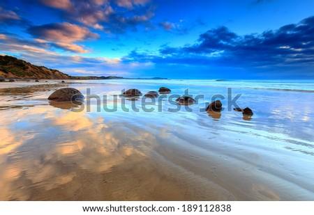 Sunrise view at Moeraki Boulders beach, New Zealand - stock photo