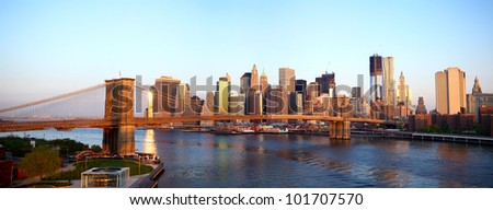 Sunrise view of Brooklyn Bridge and Lower Manhattan skyline in New York City - stock photo