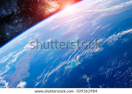 Sunrise View of Earth planet from space aerial. Elements of this image furnished by NASA