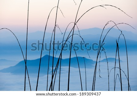 Sunrise view on misty blue cloudy Himalaya mountains