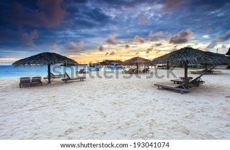 Sunrise view on white sand of Mabul Island in Borneo, Sabah, Malaysia - stock photo