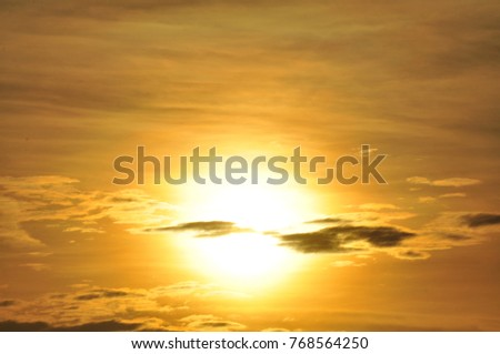 Sunrise with sky and golden clouds in early morning.