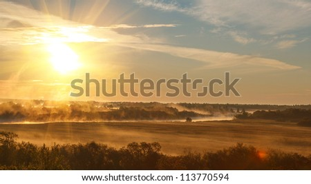 sunrise with the mist over the river and the forest in central Russia in the summer - stock photo