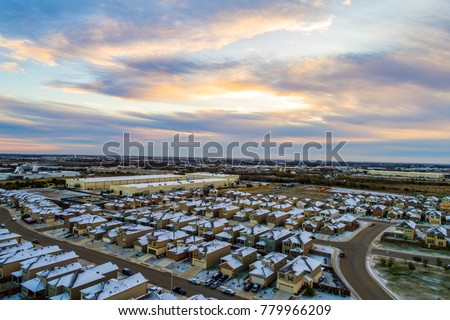 Sunrises shines on snow covered houses stock photo royalty free sunrises and shines on the snow covered houses after rare snow weather event in austin texas publicscrutiny Image collections