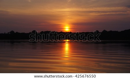 Sunsef reflections on river at rain forest in Amazonas, Brazil - stock photo