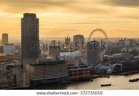 Sunset above central London with famous landmarks, skyscrapers and River Thames - London, UK - stock photo