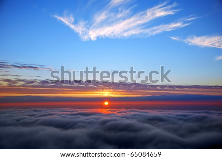 sunset above cloud line - stock photo