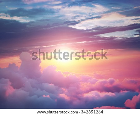 Sunset above the clouds - stock photo