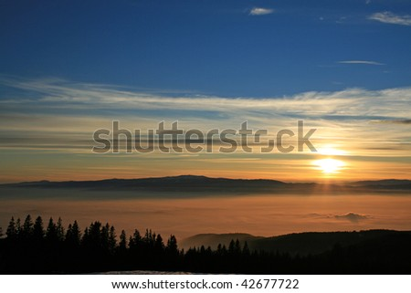 sunset above the fog - stock photo