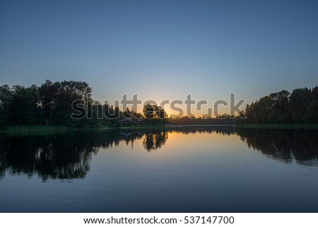 Sunset above the russian forest and lake