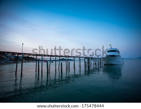 Sunset along a wooden pier at magic hour - stock photo