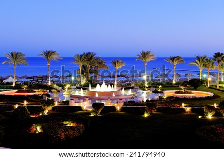 Sunset and beach of the luxury hotel, Sharm el Sheikh, Egypt - stock photo