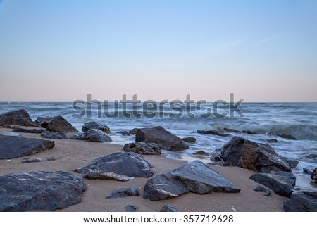 sunset and beach, Stone breakwater