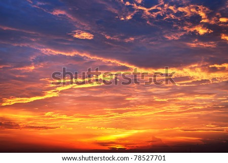 Sunset and clouds in color - stock photo