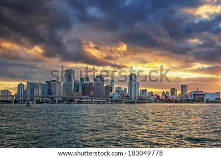 sunset and clouds with business and residential buildings, Miami, panoramic view - stock photo