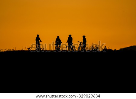 Sunset and cyclist in nature.