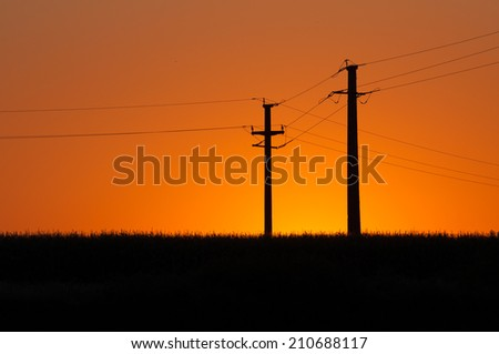 sunset and electric pylons