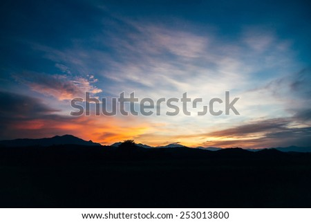 sunset  and field  the mountain  - stock photo