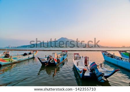 sunset and fish boat , the new Taipei, Taiwan - stock photo