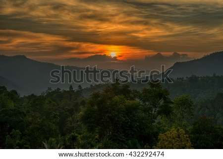 Sunset and foggy mountain valley landscape