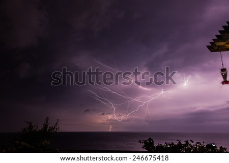 Sunset and lightning at Blue Bay Curacao   in the Dutch Antilles a Caribbean Island - stock photo