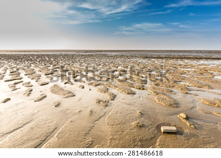 Sunset and low tide on the wadden sea - stock photo