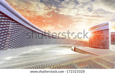 Sunset and modern outdoor metal architecture - stock photo