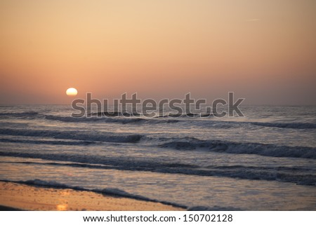 Sunset and Ocean Waves - stock photo