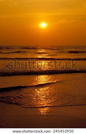 Sunset and reflected sky in the water. - stock photo