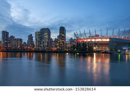 Sunset and reflections of downtown Vancouver and BC Place