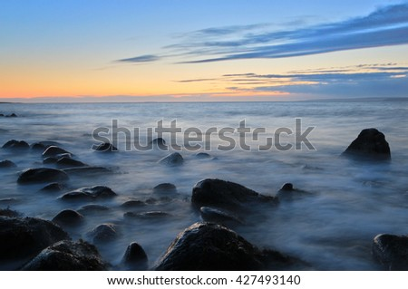 Sunset and rocks in ocean