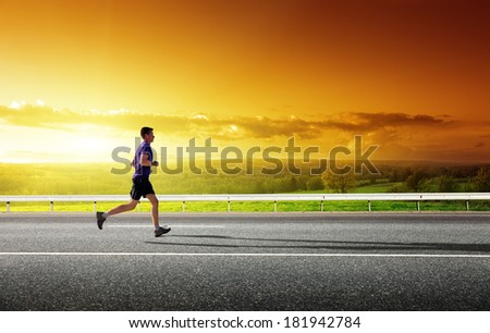 sunset and running young man  - stock photo
